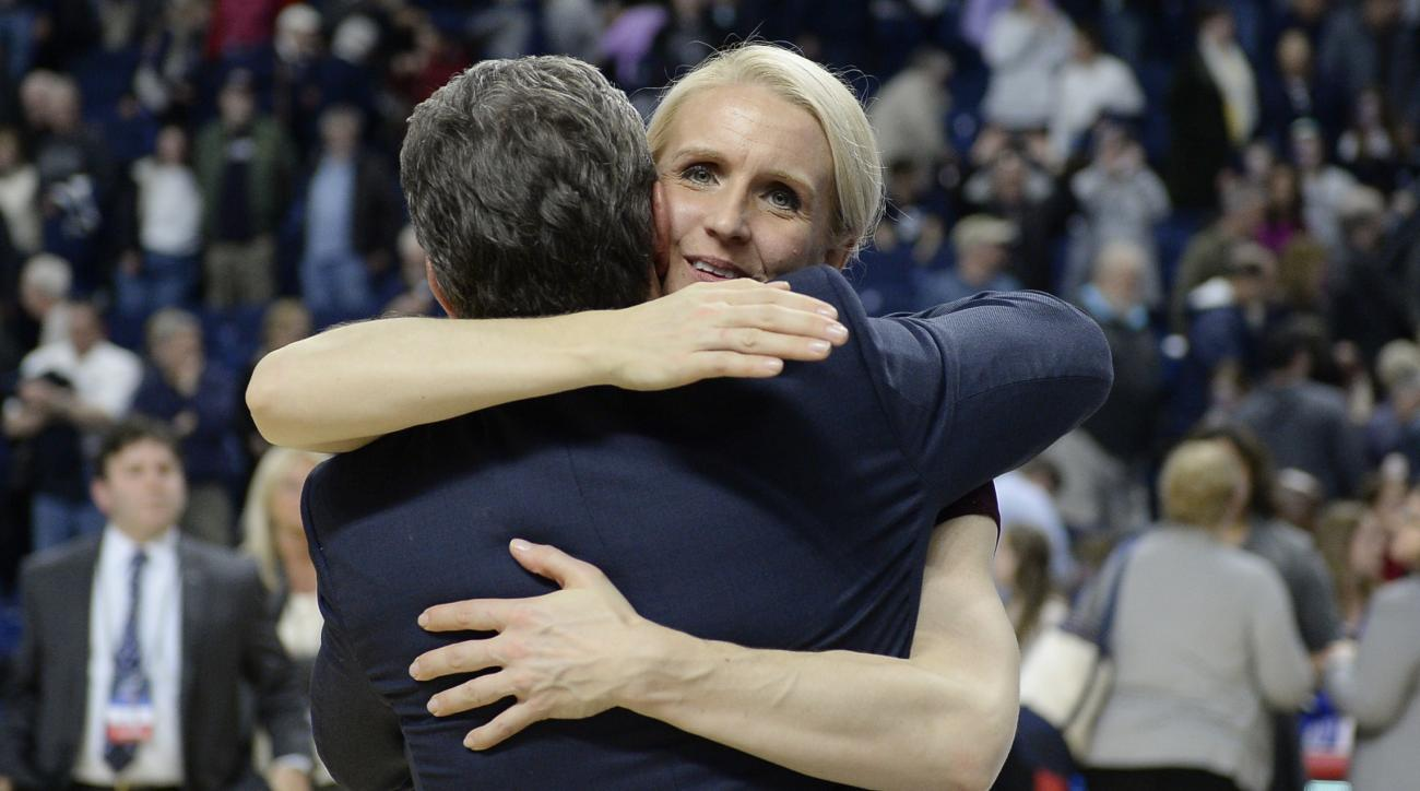 In this March 28, 2016 photo, Connecticut assistant coach Shea Ralph embraces coach Geno Auriemma after UConn defeated Texas in the regional final of the women's NCAA basketball tournament in Bridgeport, Conn.  Ralph, a former UConn player and national pl