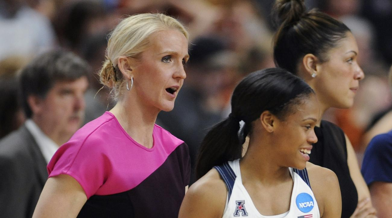 In this March 28, 2016 photo, Connecticut assistant coach Shea Ralph, left, talks with player Moriah Jefferson after UConn defeated Texas in the regional final of the women's NCAA college basketball tournament in Bridgeport, Conn. Ralph, a former UConn pl