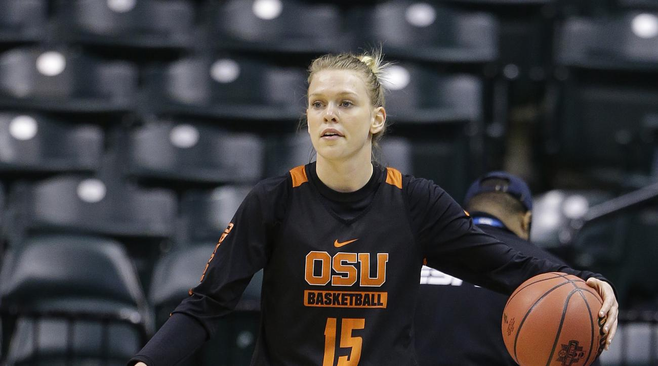 Oregon State's Jamie Weisner (15) dribbles during college basketball practice for the women's Final Four in the NCAA Tournament Saturday, April 2, 2016, in Indianapolis. (AP Photo/Michael Conroy)