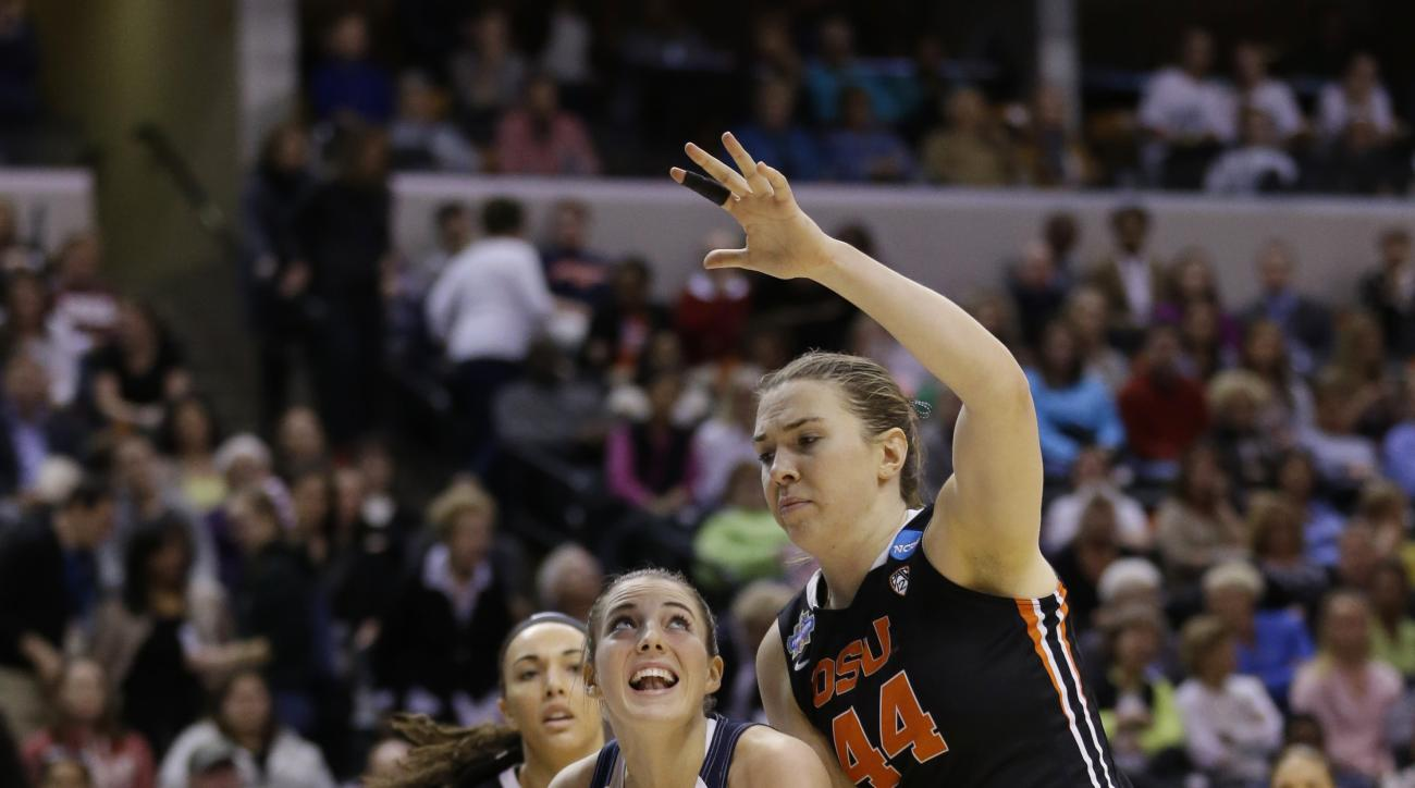 Connecticut's Katie Lou Samuelson (33) goes to the basket against Oregon State's Ruth Hamblin (44) during the first half of a national semifinal game at the women's Final Four in the NCAA college basketball tournament Sunday, April 3, 2016, in Indianapoli