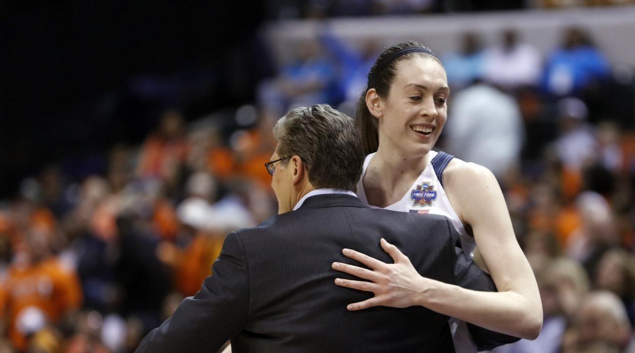 Connecticut's Breanna Stewart (30) is greeted by head coach Geno Auriemma as she is taken out of the game during the second half of a national semifinal game against Oregon State, at the women's Final Four in the NCAA college basketball tournament Sunday,