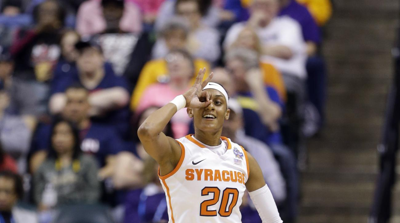 Syracuse's Brittney Sykes (20) reacts to a three-point basket during the first half of a national semifinal game against Washington, at the women's Final Four in the NCAA college basketball tournament Sunday, April 3, 2016, in Indianapolis. (AP Photo/Mich