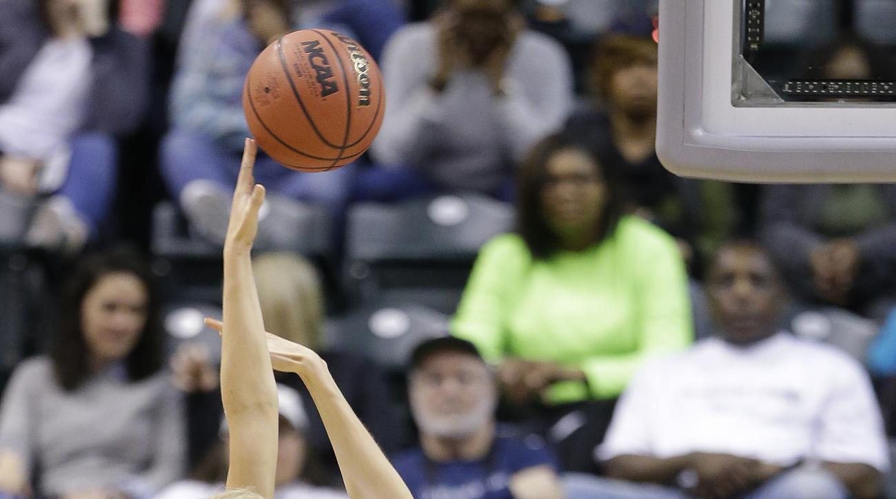 Alaska Anchorage's Alysha Devine puts up a shot against Lubbock Christian's Tess Bruffey during the first half of the championship game at the women's NCAA Division II basketball tournament Monday, April 4, 2016, in Indianapolis. (AP Photo/Michael Conroy)