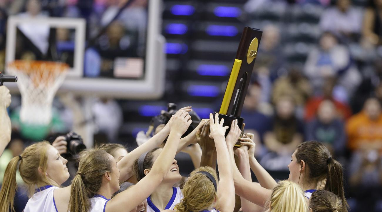 Lubbock Christian hold the championship trophy after defeating Alaska Anchorage, 78-73, in the championship game at the women's NCAA Division II basketball tournament Monday, April 4, 2016, in Indianapolis. (AP Photo/Michael Conroy)