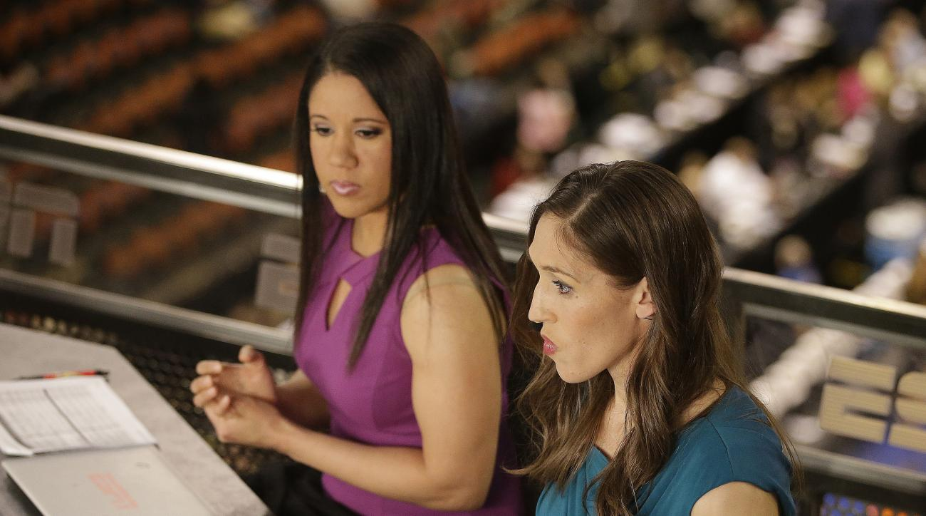 In this Sunday, April 3, 2016 photo, Kara Lawson, left, and Rebecca Lobo prepare for a ESPN show before a national semifinal game at the women's Final Four in the NCAA college basketball tournament in Indianapolis. The witty banter that viewers see on-air