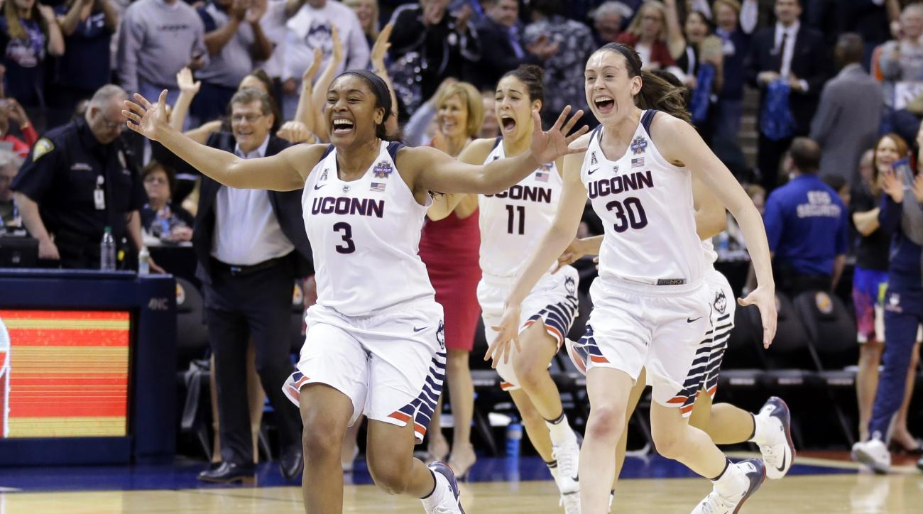 Connecticut's Morgan Tuck (3), Kia Nurse (11) and Breanna Stewart (30) celebrate after Connecticut's 82-51 victory over Syracuse in the championship game at the women's Final Four in the NCAA college basketball tournament Tuesday, April 5, 2016, in Indian