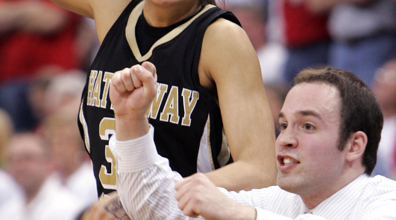FILE - In this March 21, 2009, file photo, then-Shaker Heights Hathaway Brown assistant coach Bryce McKey reacts to a play late in the fourth quarter of the Division II girls Ohio state basketball championship game against Wapakoneta, in Columbus, Ohio. U