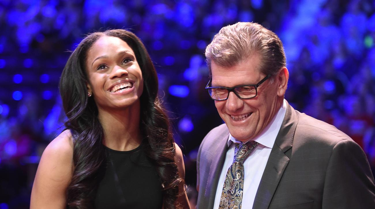 Connecticut's Moriah Jefferson smiles after being congratulated by UConn coach Geno Auriemma, right, after the San Antonio Stars selected Jefferson with the second pick in theWNBA basketball draft, Thursday, April 14, 2016, in Uncasville, Conn. (Cloe Pois