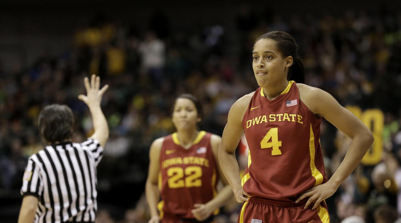 FILE - In this March 11, 2013 file photo, Iowa State guard Nikki Moody (4) pauses for a moment after a Baylor score as Brynn Williamson (22) enters the game during an NCAA college basketball championship game in the Big 12 Conference tournament, in Dallas