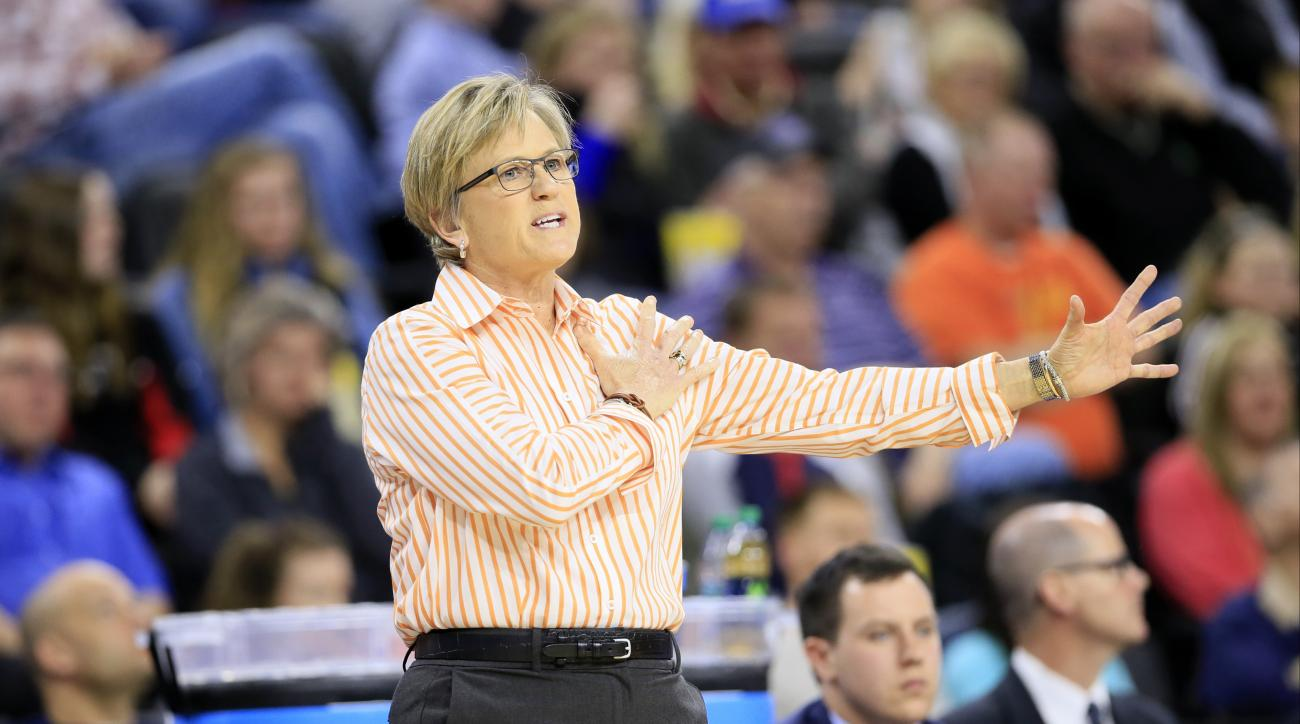 Tennessee head coach Holly Warlick directs her team during the second half of a regional final women's college basketball game against Syracuse in the NCAA Tournament, Sunday, March 27, 2016, in Sioux Falls, S.D. (AP Photo/Charlie Neibergall)
