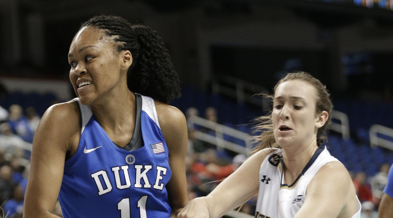 Notre Dame's Marina Mabrey (3) reaches for a the ball as Duke's Azura Stevens (11) drives to the basket during the first half of an NCAA college basketball game in the Atlantic Coast Conference tournament in Greensboro, N.C., Friday, March 4, 2016. (AP Ph