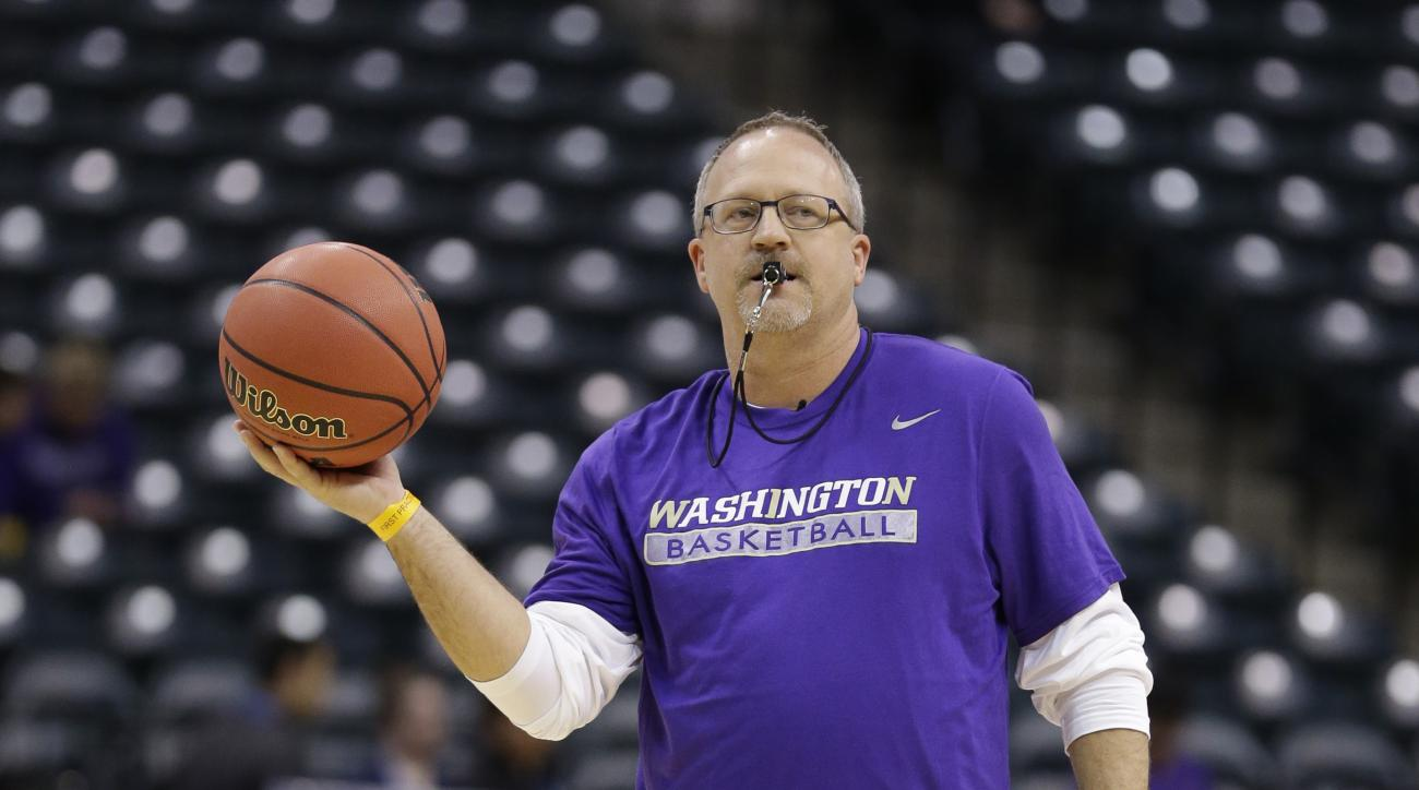Washington head coach Mike Neighbors makes a pass during college basketball practice for the women's Final Four in the NCAA Tournament Saturday, April 2, 2016, in Indianapolis. (AP Photo/Michael Conroy)