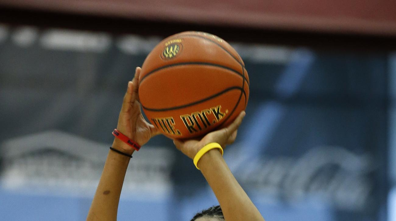 Taja Cole, of Richmond, Va., competes in the three-point shootout during the McDonald's All-American Jam Fest, Monday, March 30, 2015, in Chicago. (AP Photo/Andrew A. Nelles)