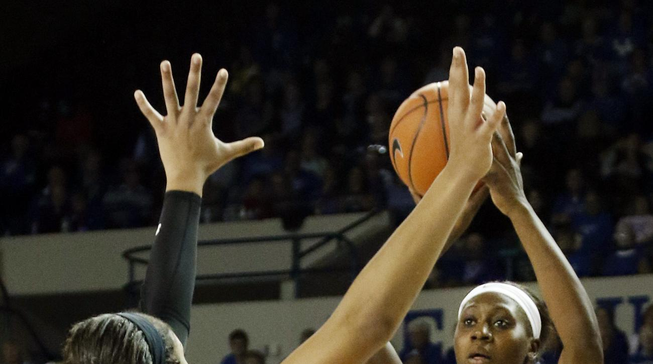 Kentucky's Batouly Camara (1) shoots while defended by South Carolina's A'ja Wilson during an NCAA college basketball game Thursday, Jan. 14, 2016, in Lexington, Ky. South Carolina won 73-62. (AP Photo/James Crisp)