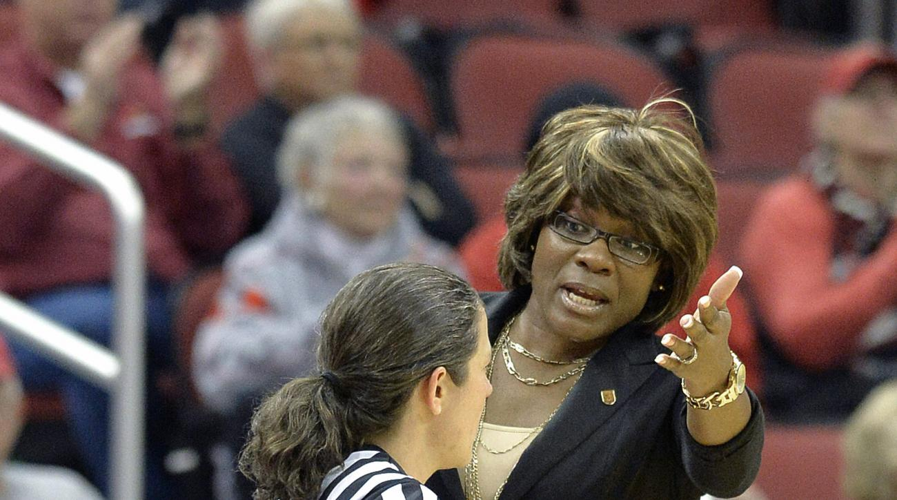 FILE- In this Nov. 9, 2013, file photo, Loyola of Chicago coach Sheryl Swoopes, right, argues a call with referee Erica Bradley during an NCAA college basketball game in Louisville, Ky. Swoopes was part of the 1996 U.S. women's basketball team. Their succ