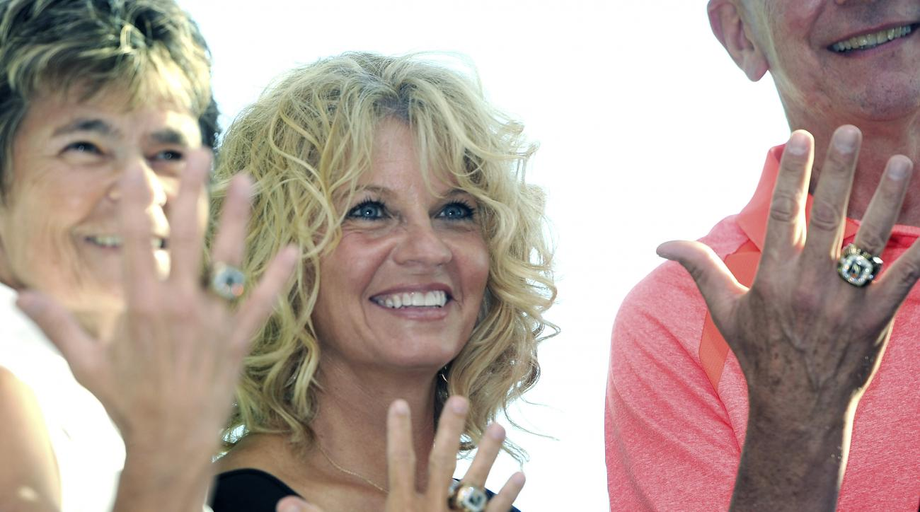 Oklahoma women's basketball coach Sherri Coale, center, displays a new ring beside fellow inductees June Courteau, left, and Joe Lombard, right, following a ceremony at the Women's Basketball Hall of Fame in Knoxville, Tenn., Friday, June 10, 2016. (Adam