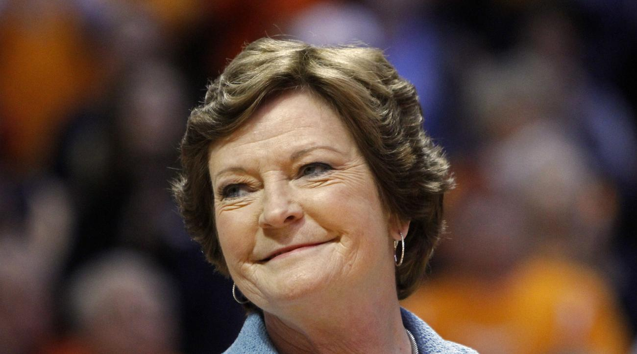 FILE - In this Jan. 28, 2013, file photo, former Tennessee women's basketball coach Pat Summitt smiles as a banner is raised in her honor before the team's NCAA college basketball game against Notre Dame in Knoxville, Tenn. Summitt, the winningest coach i