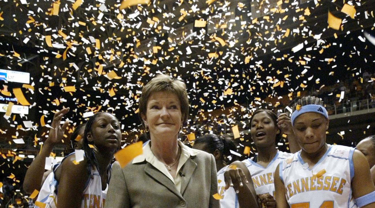 FILE - In this Jan. 14, 2003, file photo, Tennessee head coach Pat Summitt, center, smiles as she stands with her team after defeating DePaul, 76-57, to get her 800th career win, in Knoxville, Tenn. Tye'sha Fluke is at left, Courtney McDaniel (34), right,