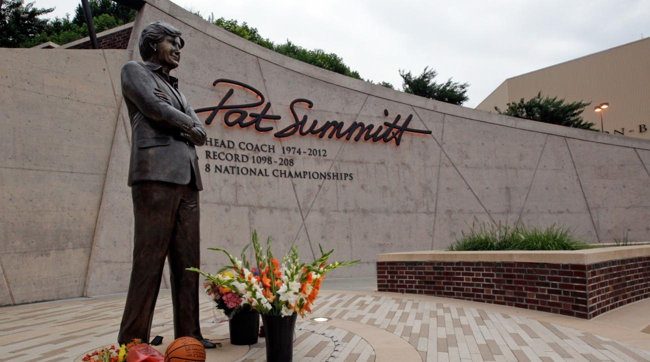 Flowers lay alongside a basketball fans have left at the Pat Summitt statue Tuesday, June 28, 2016, in Knoxville, Tenn.  Summitt, the winningest coach in Division I college basketball history who uplifted the women's game from obscurity to national promin