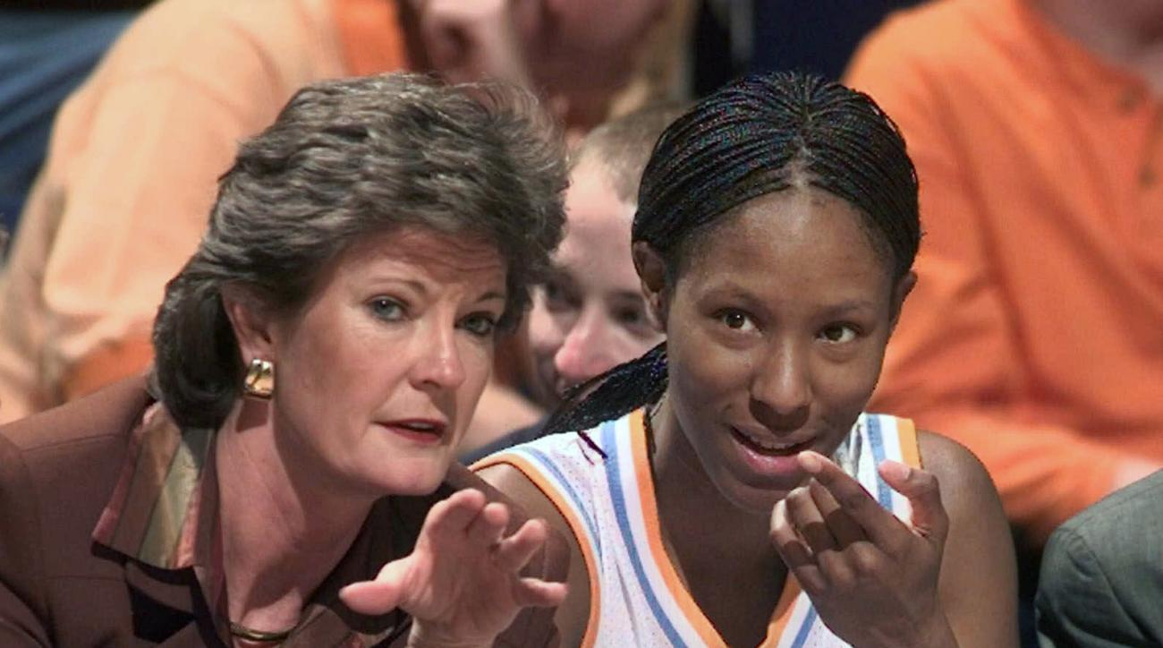 FILE - In this Feb. 26, 1999, file photo, Tennessee head coach Pat Summitt talks with Chamique Holdsclaw on the bench as Holdsclaw ices her knees in the final minutes of their game against Florida at the SEC women's tournament in Chattanooga, Tenn. Summit