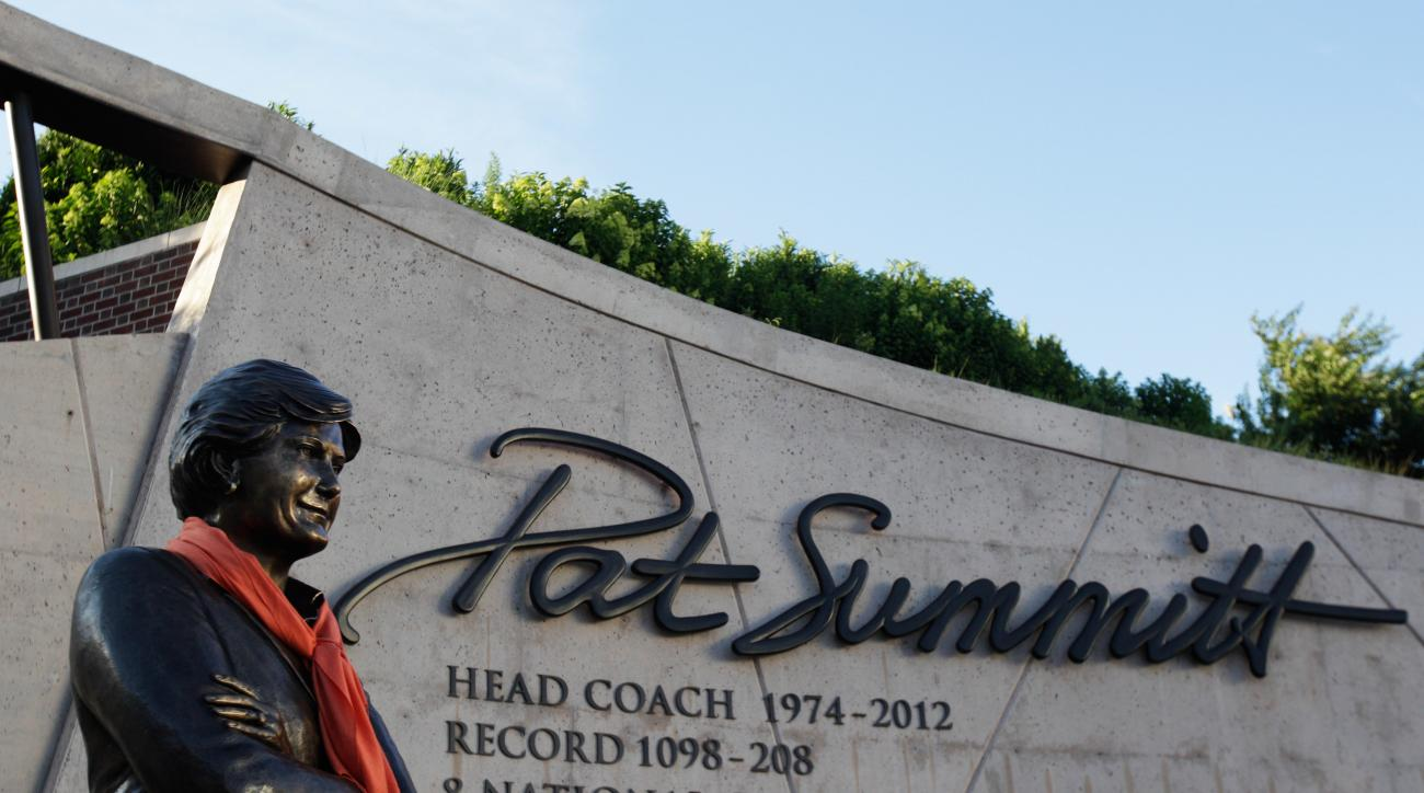 An orange scarf is placed around the statue of Pat Summitt before a candlelight vigil at the Pat Summitt Plaza, Wednesday, June 29, 2016, in Knoxville, Tenn. Summitt, the winningest coach in Division I college basketball history who uplifted the women's g