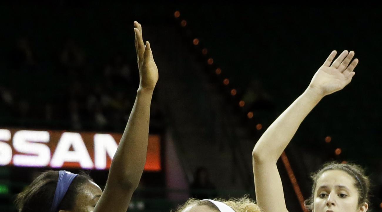 Baylor forward Justis Szczepanski (11) works to the basket against Oral Roberts' Faith Ihim (15) , left, and Maria Martianez (44) during an NCAA college basketball game, Thursday, Dec. 17, 2015, in Waco, Texas. (AP Photo/Tony Gutierrez)