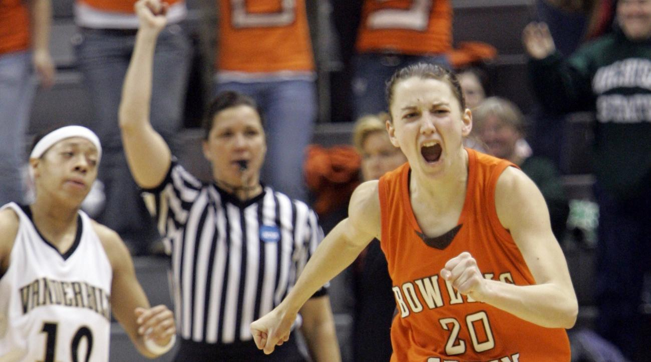 Bowling Green guard Kate Achter (20) runs in front of Vanderbilt guard Dee Davis (10) as she celebrates her team's upset win in an NCAA women's second-round basketball tournament game in East Lansing, Mich., Tuesday, March 20, 2007. Bowling Green dominate