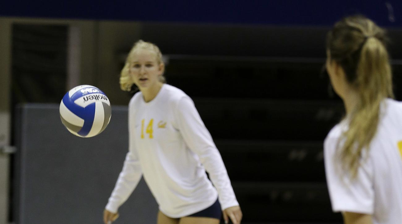 In this photo taken Tuesday, Aug. 30, 2016, Savannah Rennie, who underwent a liver transplant, sets up the ball during volleyball practice at the University of California, Berkeley in Berkeley, Calif. Rennie returned to Cal early in August following five