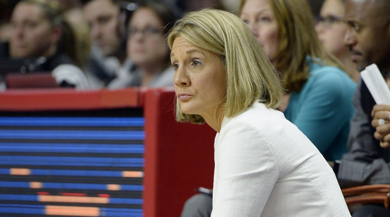 Texas head coach Karen Aston reacts during the second half of a college basketball game against Connecticut in the regional final of the women's NCAA Tournament , Monday, March 28, 2016, in Bridgeport, Conn. UConn 86-65. (AP Photo/Jessica Hill)
