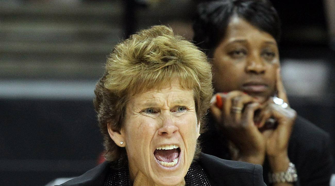 San Diego State head coach Beth Burns instructs her team during the first half of the Mountain West Conference tournament championship NCAA college basketball game against Fresno State, Saturday, March 16, 2013, in Las Vegas. (AP Photo/Isaac Brekken)