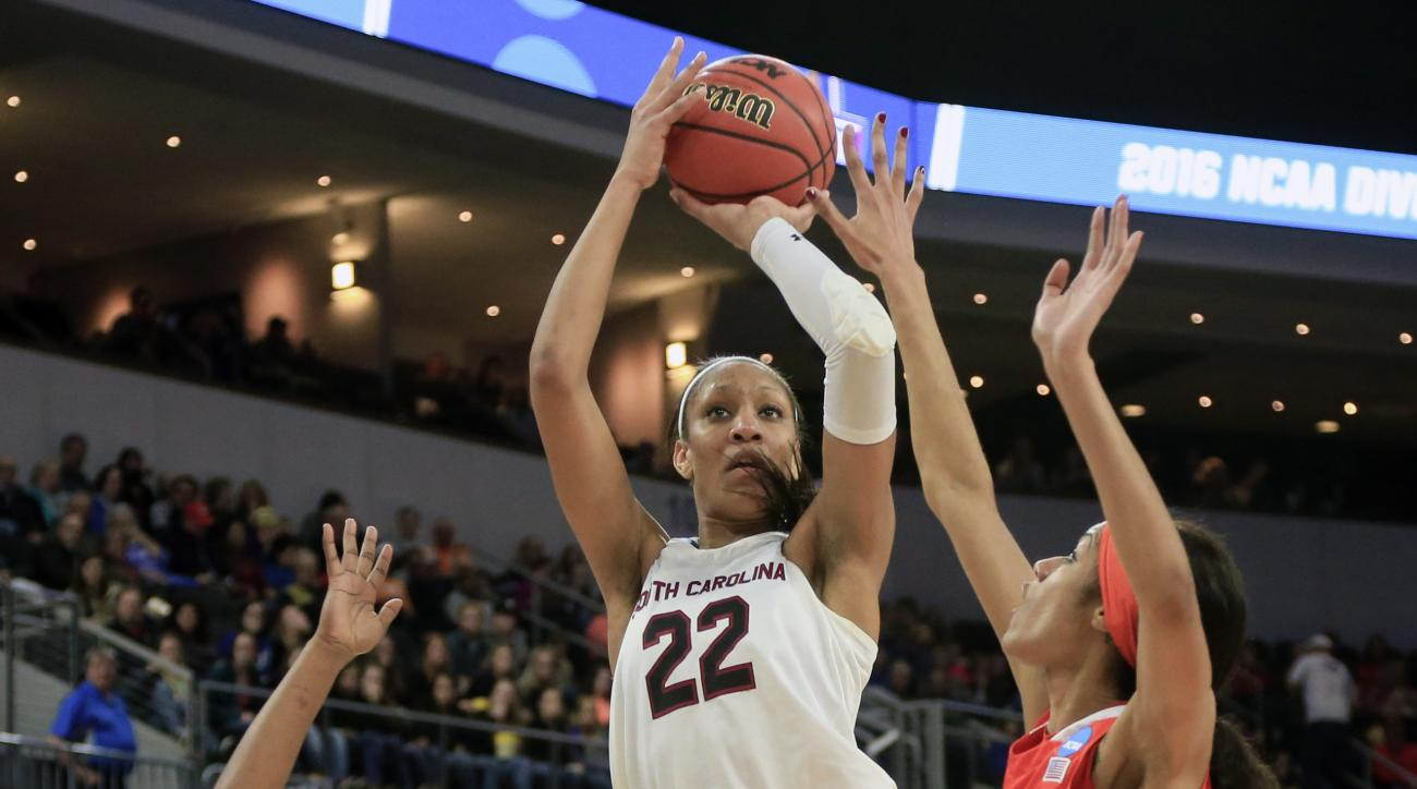 FILE - In this March 25, 2016, file photo, South Carolina's A'ja Wilson (22) shoots between Syracuse's Taylor Ford (22) and Briana Day (50), during a women's college basketball regional semifinal game in the NCAA Tournament in Sioux Falls, S.D. Wilson was