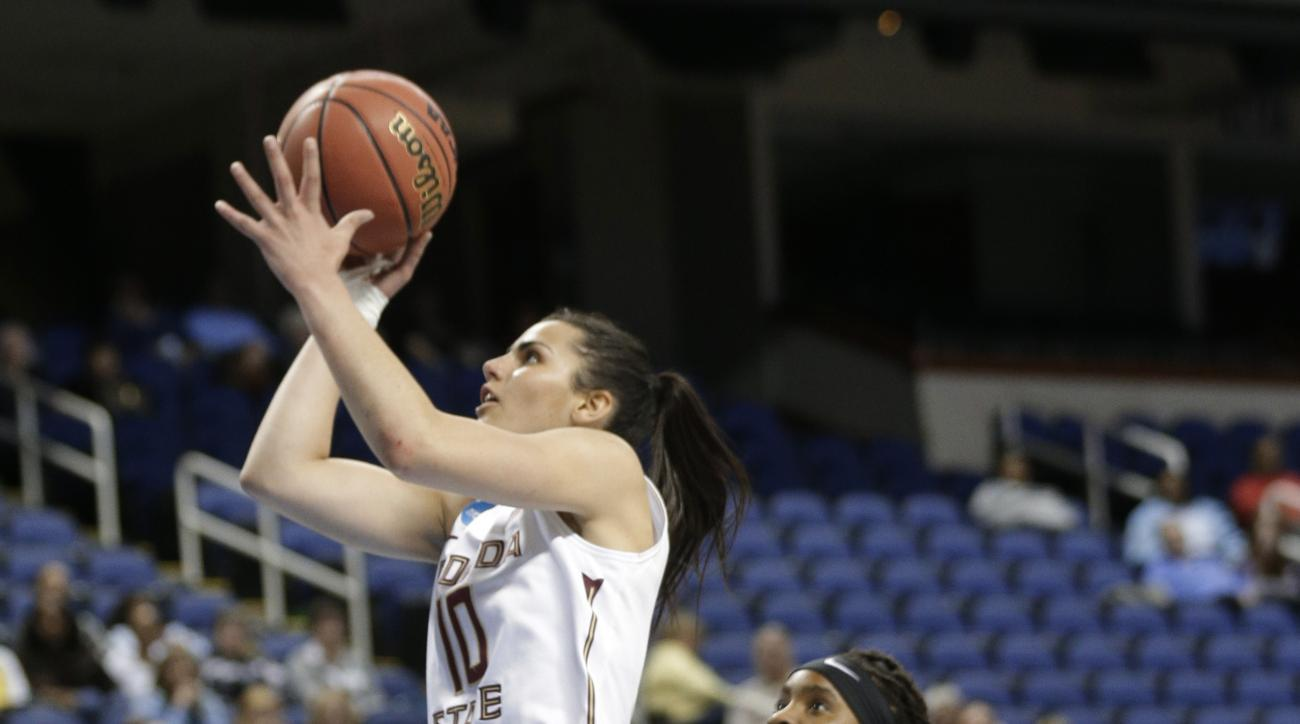 FILE - In this March 27, 2015, file photo, Florida State's Leticia Romero (10) drives past Arizona State's Peace Amukamara (11) in the second half of a women's college basketball regional semifinal game in the NCAA Tournament in Greensboro, N.C. Leticia R