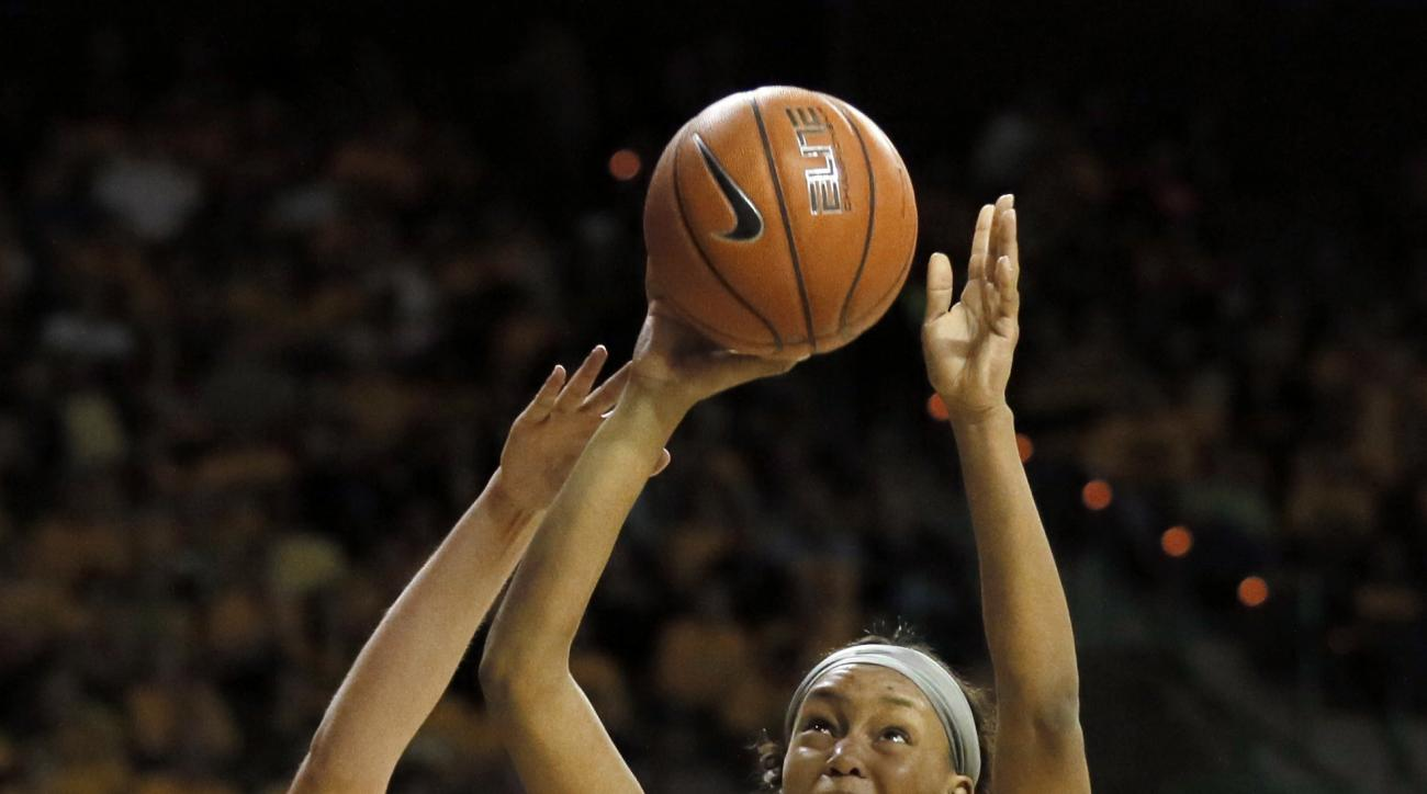 FILe - In this Feb. 29, 2016, file photo, Texas' Kelsey Lang (40) defends as Baylor's Nina Davis (13) goes up for a shot attempt in the second half of an NCAA college basketball game, in Waco, Texas. The Lady Bears had their last three seasons end with lo
