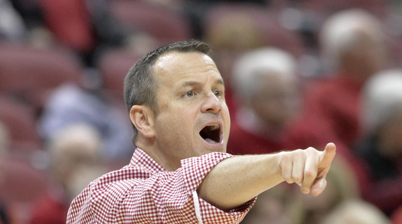 Louisville head coach Jeff Walz directs his team during the second half of an NCAA college basketball game against Belmont, Sunday, Nov. 13, 2016 in Louisville Ky. Louisville won 73-50. (AP Photo/Timothy D. Easley)