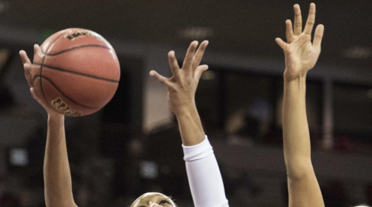 South Carolina forward A'ja Wilson (22) shoots between St. Peter's Sajanna Bethea, right, and Talah Hughes during the first half of an NCAA college basketball game Tuesday, Nov. 22, 2016, in Columbia, S.C. South Carolina won 93-38. (AP Photo/Sean Rayford)