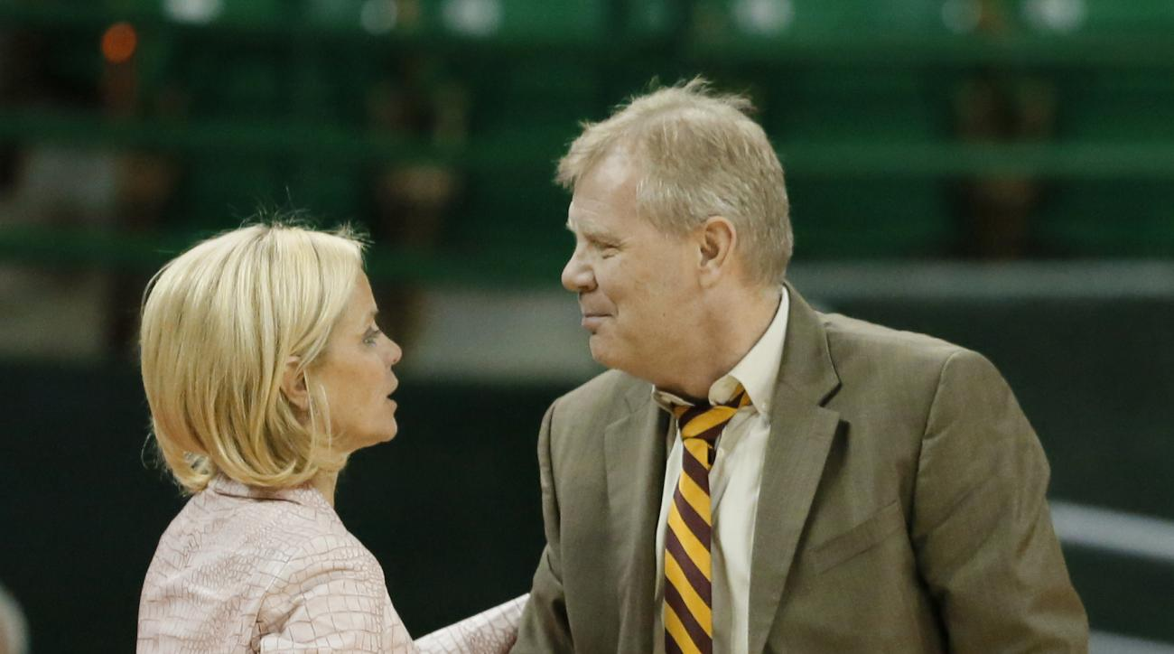 Baylor head coach Kim Mulkey, left, and Winthrop head coach Kevin Cook, right, greet each other after their NCAA college basketball game, Thursday, Dec. 15, 2016, in Waco, Texas. Baylor won 140-32. (AP Photo/Tony Gutierrez)