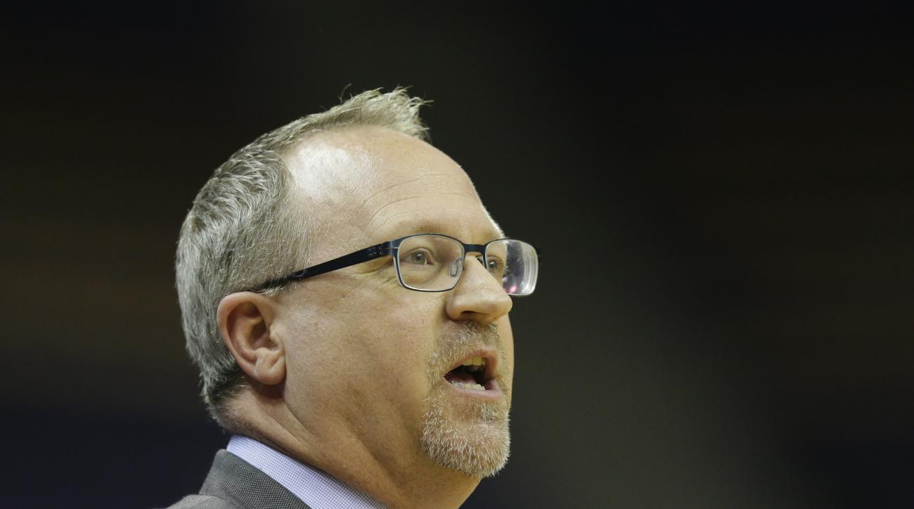 FILE - In this Sunday, Dec. 18, 2016, file photo, Washington head coach Mike Neighbors watches from the sideline in the second half of an NCAA college basketball game against Savannah State in Seattle. Mike Neighbors loves to crunch numbers. Washington's