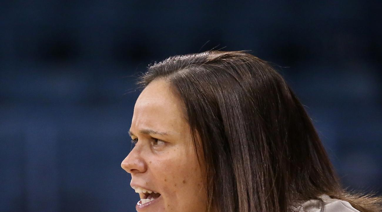 Appalachian State head coach Angel Elderkin cheers for her team during a 84-52 loss to North Carolina in an NCAA college basketball game in Chapel Hill, N.C., Sunday, Dec. 14, 2014. (AP Photo/Ted Richardson)