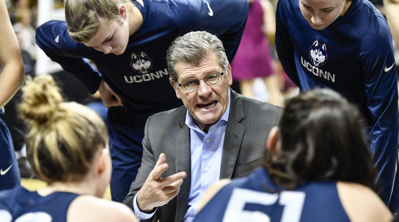 Connecticut coach Geno Auriemma gives instruction to his team during the second half of an NCAA college basketball game against UCF on Sunday, Jan. 1, 2017, in Orlando, Fla. Connecticut defeated UCF 84-48. (AP Photo/Roy K. Miller)