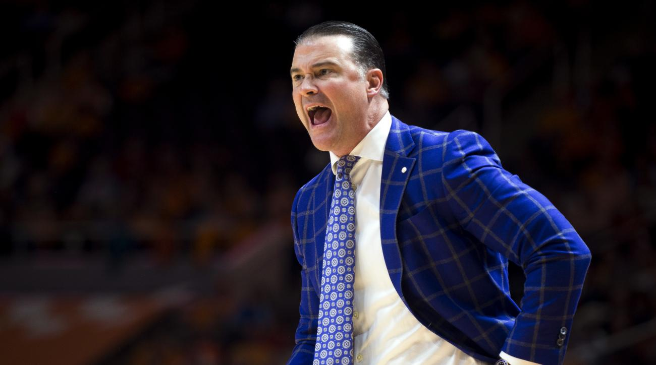 FILE - In this Jan. 1, 2017, file photo, Kentucky head coach Matthew Mitchell yells to his players during the first half of an NCAA college basketball game against Tennessee in Knoxville, Tenn. Kentucky's run in The Associated Press women's basketball pol