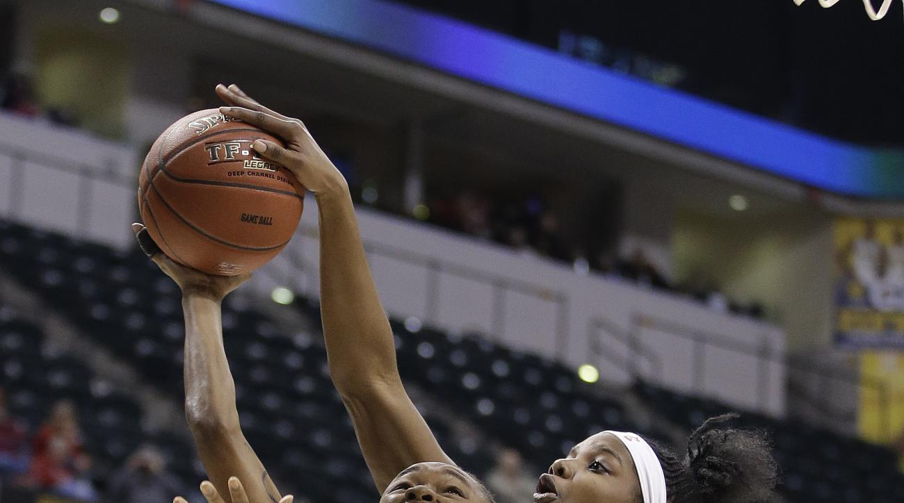 Northwestern's Jordan Hankins (5) has her shot blocked by Maryland's Brianna Fraser (34) during the second half of an NCAA college basketball game at the Big Ten Conference tournament Saturday, March 5, 2016, in Indianapolis. (AP Photo/Darron Cummings)