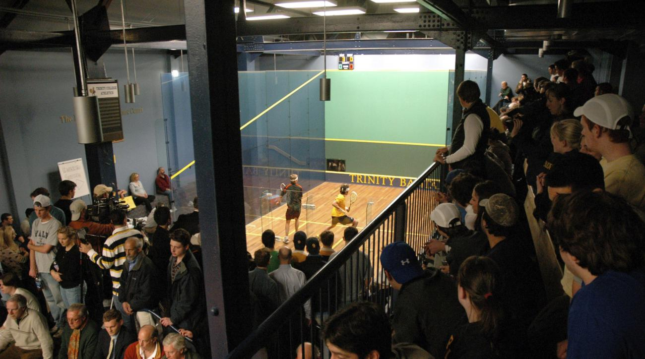 FILE - In this Jan. 30, 2008 file photo spectators crammed the lofts to watch Princeton University's David Letourneau in a match against Trinity College's Manek Mathur, Jr. (yellow jersey) at the George A. Kellner Squash Center on the campus of Trinity Co