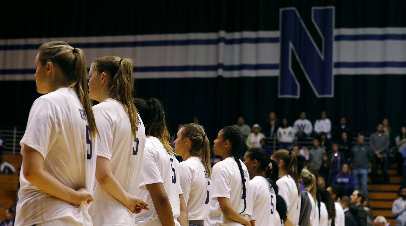 Northwestern women's NCAA college basketball players, all wearing the jersey number of teammate Jordan Hankins, take part in a pregame ceremony at the Welsh Ryan Arena in Evanston, Ill., Saturday, Jan. 14, 2017. Hankins, 19, a sophomore from Indianapolis,