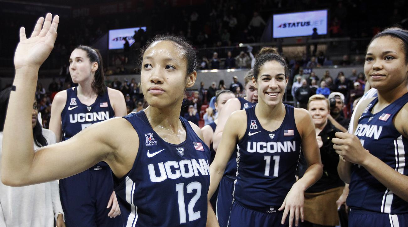 Connecticut guard Saniya Chong (12) and her teammates wave to fans after an NCAA college basketball game against SMU, Saturday, Jan. 14, 2017, in Dallas. Connecticut won 88-48, their 91st straight win. (AP Photo/Brandon Wade)