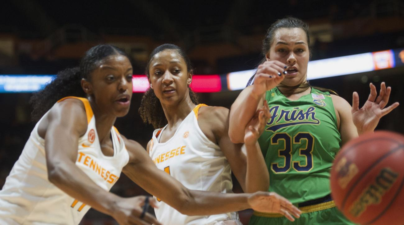Tennessee's Diamond DeShields, left, and Jaime Nared chase after the ball with Notre Dame's Kathryn Westbeld during an NCAA college basketball game in Knoxville, Tenn., Monday, Jan. 16, 2017. (Saul Young/Knoxville News Sentinel via AP)