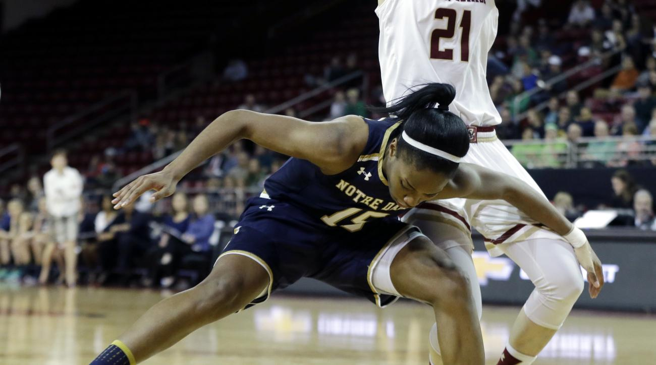 Notre Dame guard Lindsay Allen (15) loses control over the ball against Boston College guard Martina Mosetti (21) in the first half of an NCAA basketball game, Thursday, Jan.19, 2017, in Boston. (AP Photo/Elise Amendola)