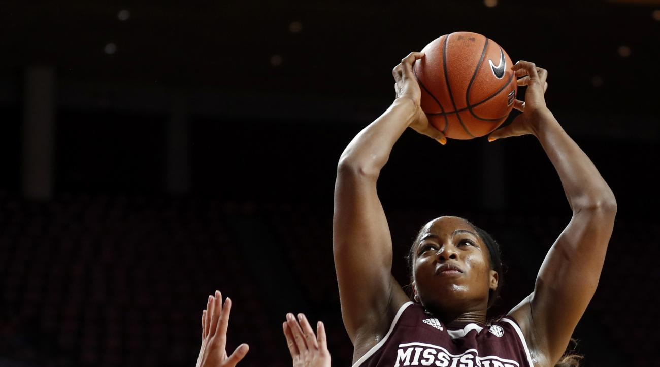 FILE - In this Dec. 3, 2016, file photo, Mississippi State center Chinwe Okorie (45) grabs a rebound over Iowa State guard Jadda Buckley (11) during the first half of an NCAA college basketball game, in Ames, Iowa. Mississippi State's roster hasn't change