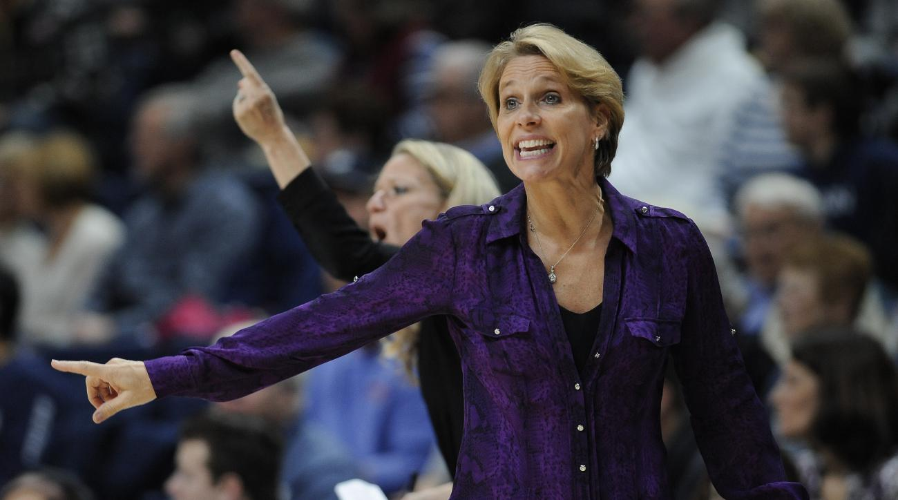 Tulane head coach LisaStockton gestures to her team in the first half of an NCAA college basketball game against Connecticut, Sunday, Jan. 22, 2017, in Storrs, Conn. (AP Photo/Jessica Hill)