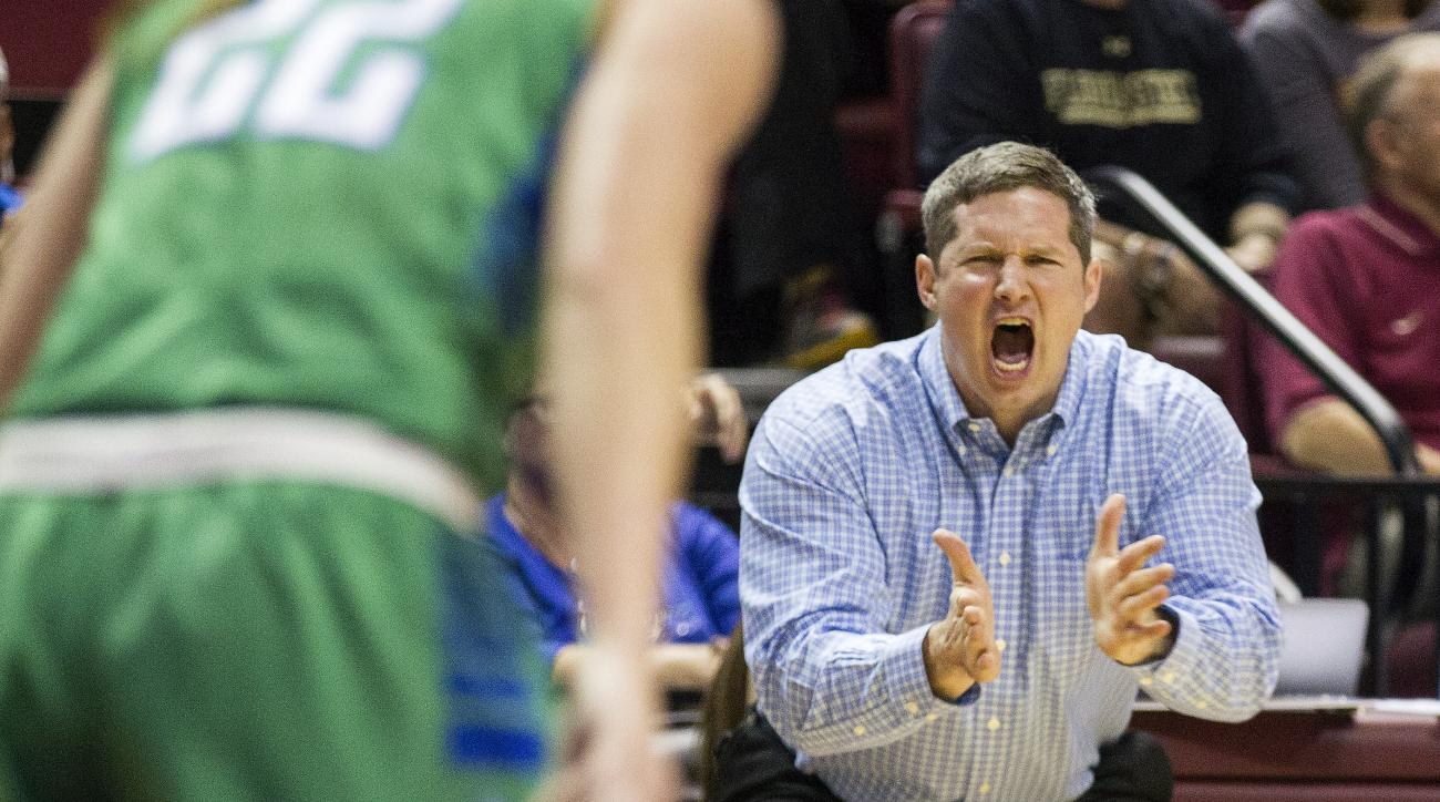 Florida Gulf Coast head coach Karl Smesko shouts at his team during the first half of a women's college basketball game in the second round of the NCAA tournament against Florida State in Tallahassee, Fla., Saturday March 23, 2015. (AP Photo/Mark Wallheis
