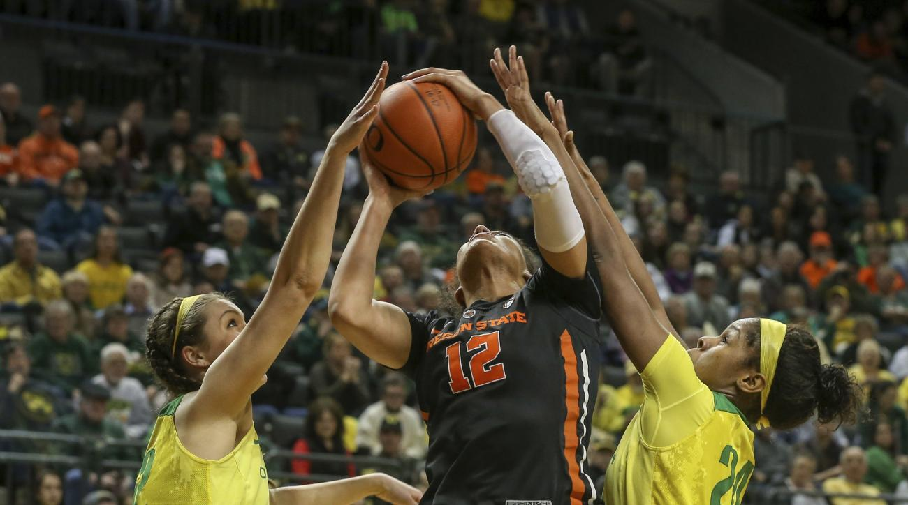 Oregon State's Kolbie Orum (12) has her shot blocked by the Oregon's Sierra Campisano, left, and Ruthy Hebard during the first half of an NCAA college basketball game in Eugene, Ore., Friday, Jan. 27, 2017. (Collin Andrew/The Register-Guard via AP)